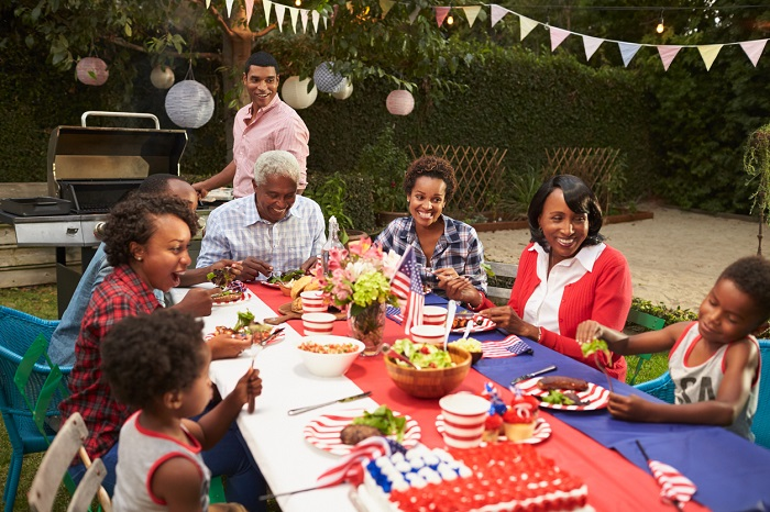 Family at the table for Fourth of July barbecue.