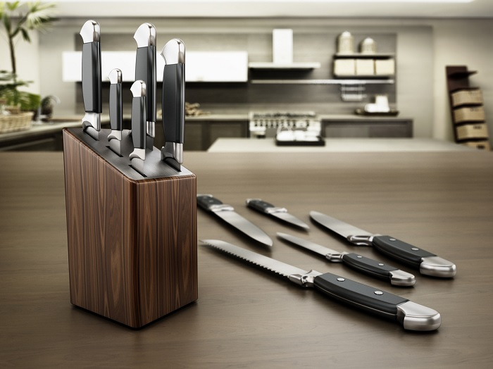 New knife set displayed in kitchen.