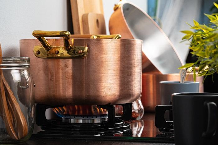 Metal pot on a gas stove burner.