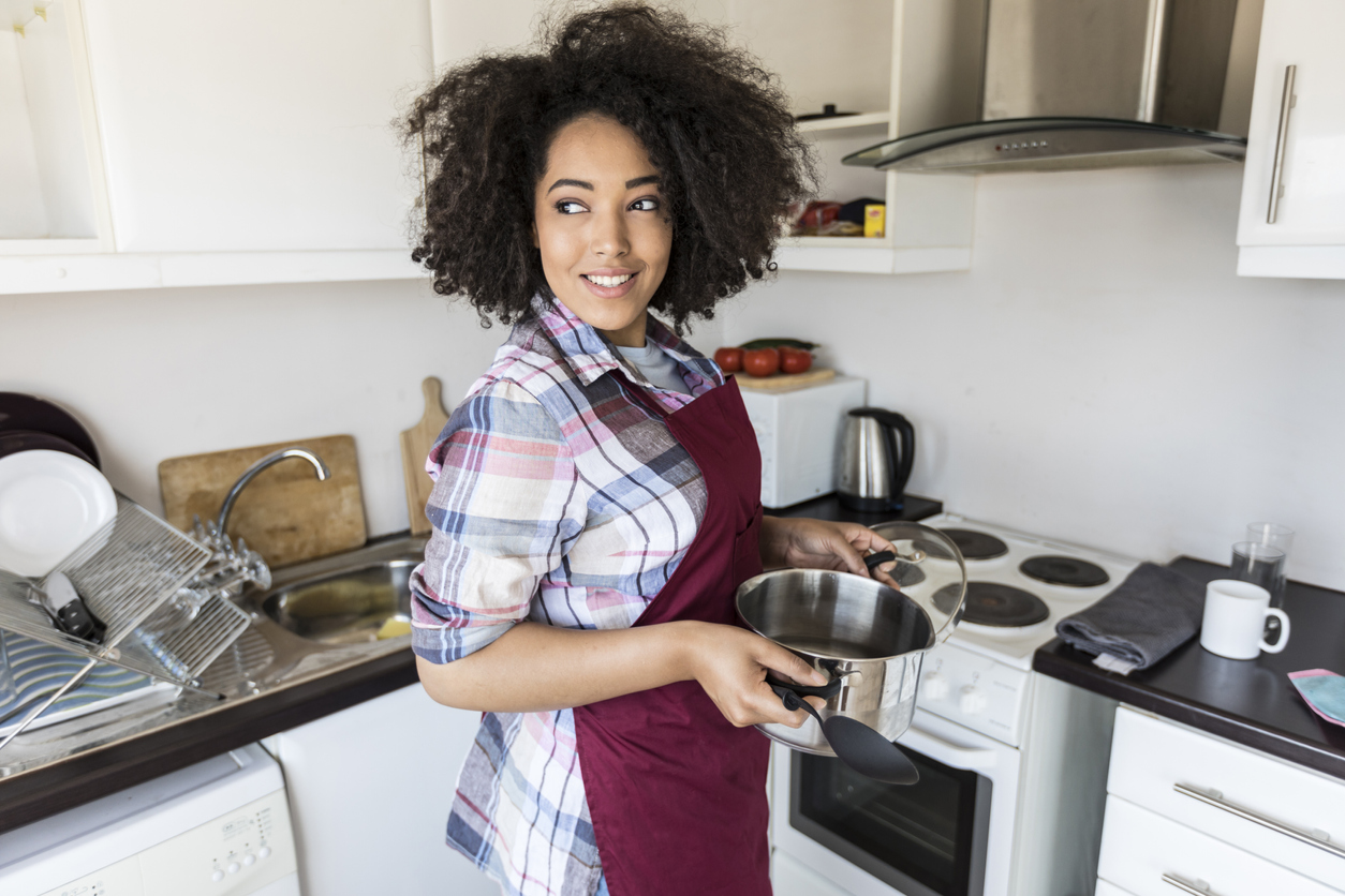woman cooking in the kitchen with electric range