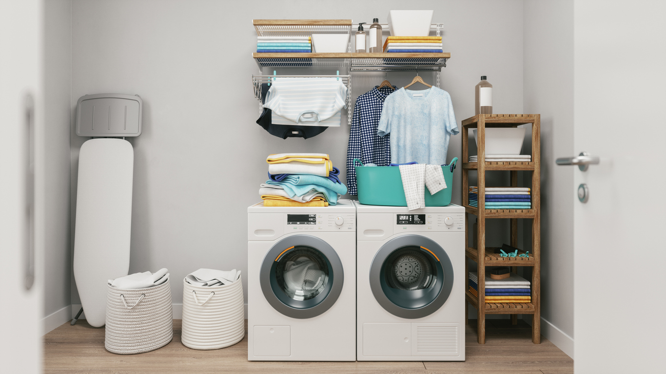 compact laundry setup featuring a wall-mounted rod for hanging clothes