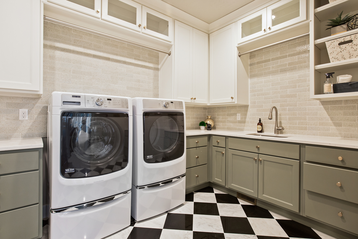 front-load washer and dryer pair with laundry pedestals