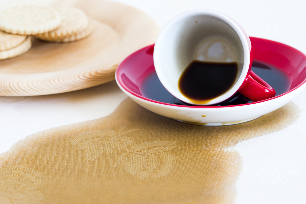 spilled coffee on white tablecloth