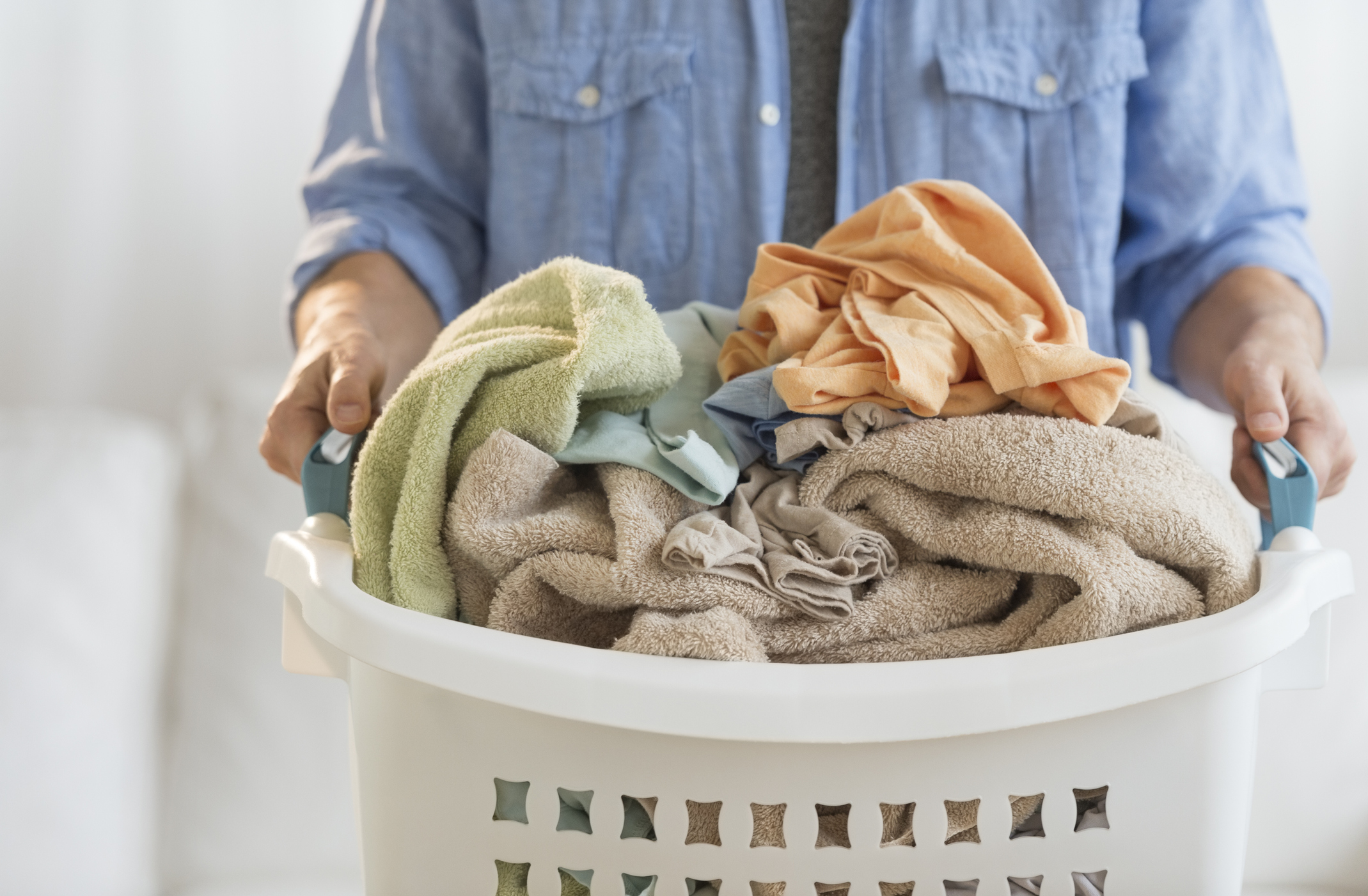 man holding laundry basket