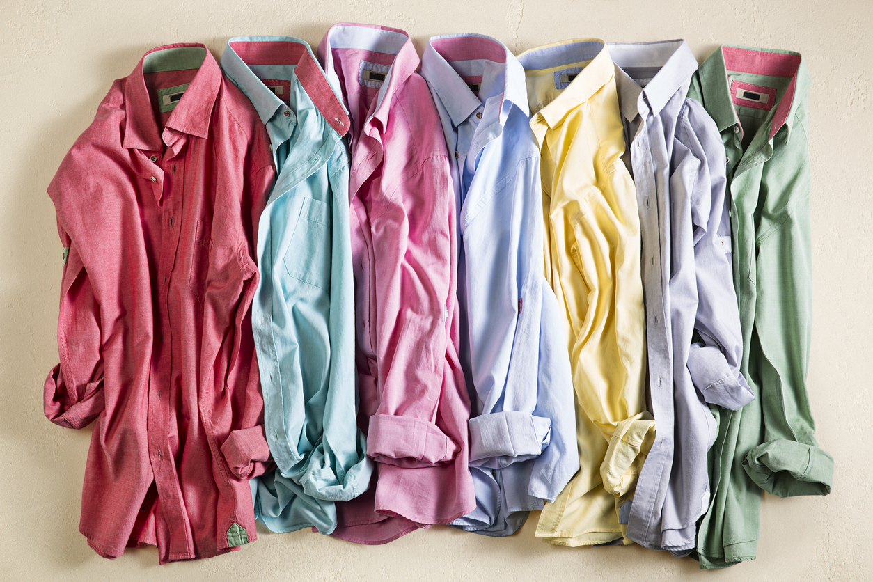 wrinkled men's shirts in an assortment of colors