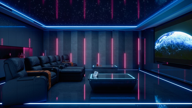 Interior of a luxurious private home cinema room with big projection screen and luxury cinema chairs.