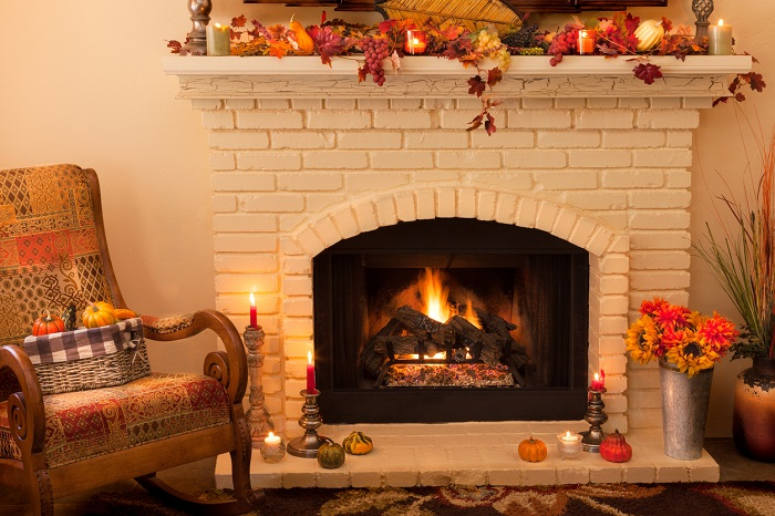 A fireplace covered with fall decor.