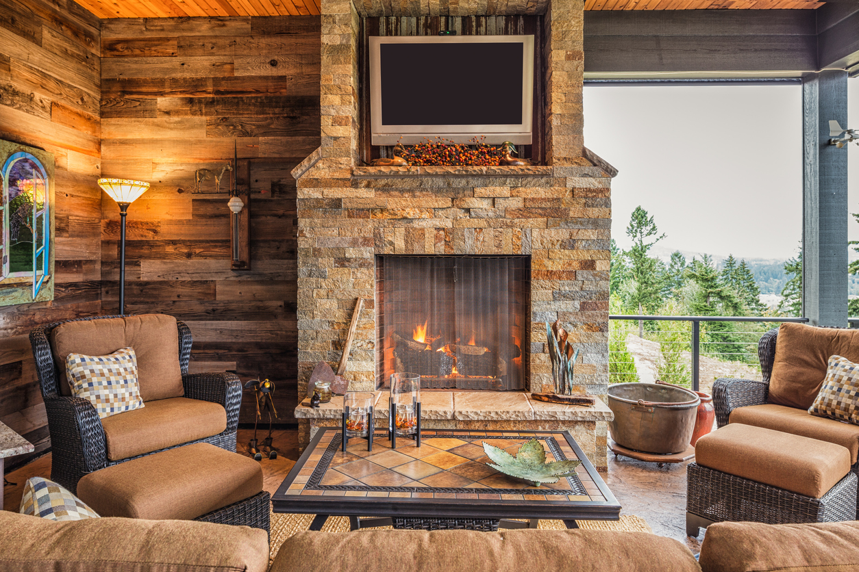Covered patio with TV and fireplace