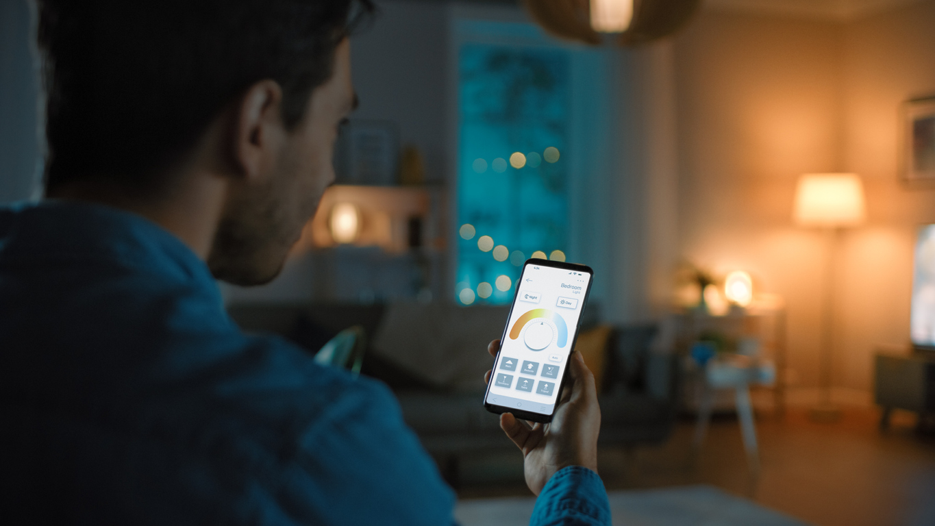 Man controls his smart lighting with voice control