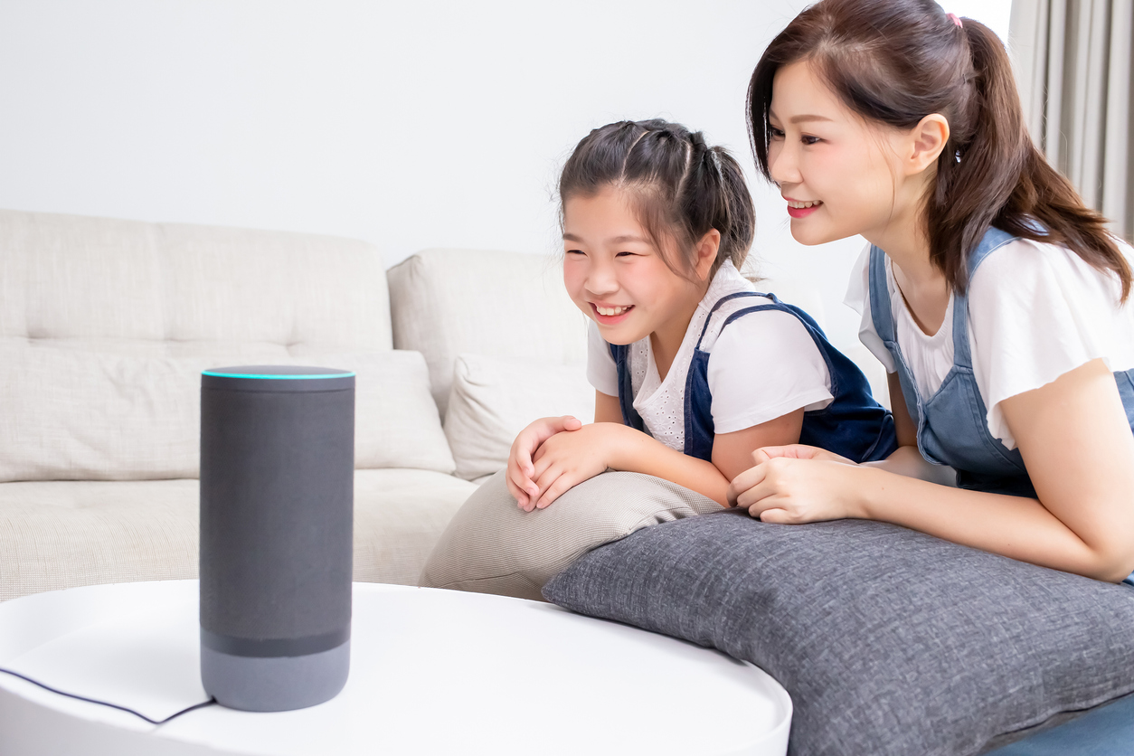 A woman and child use voice control to start their day.