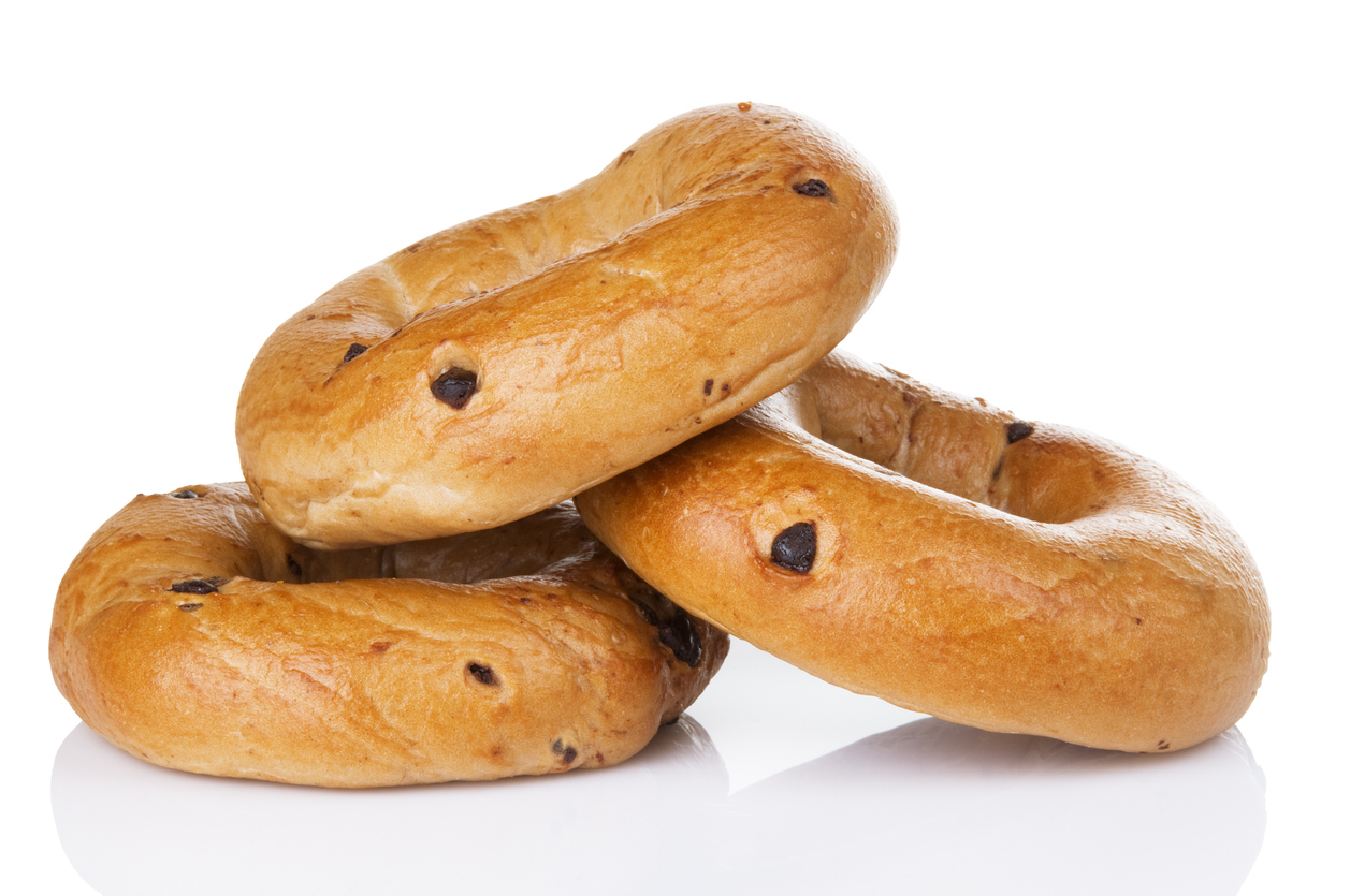 three chocolate chip bagels on a white background