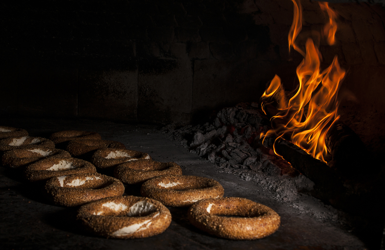 two rows of Montreal bagels in a wood oven