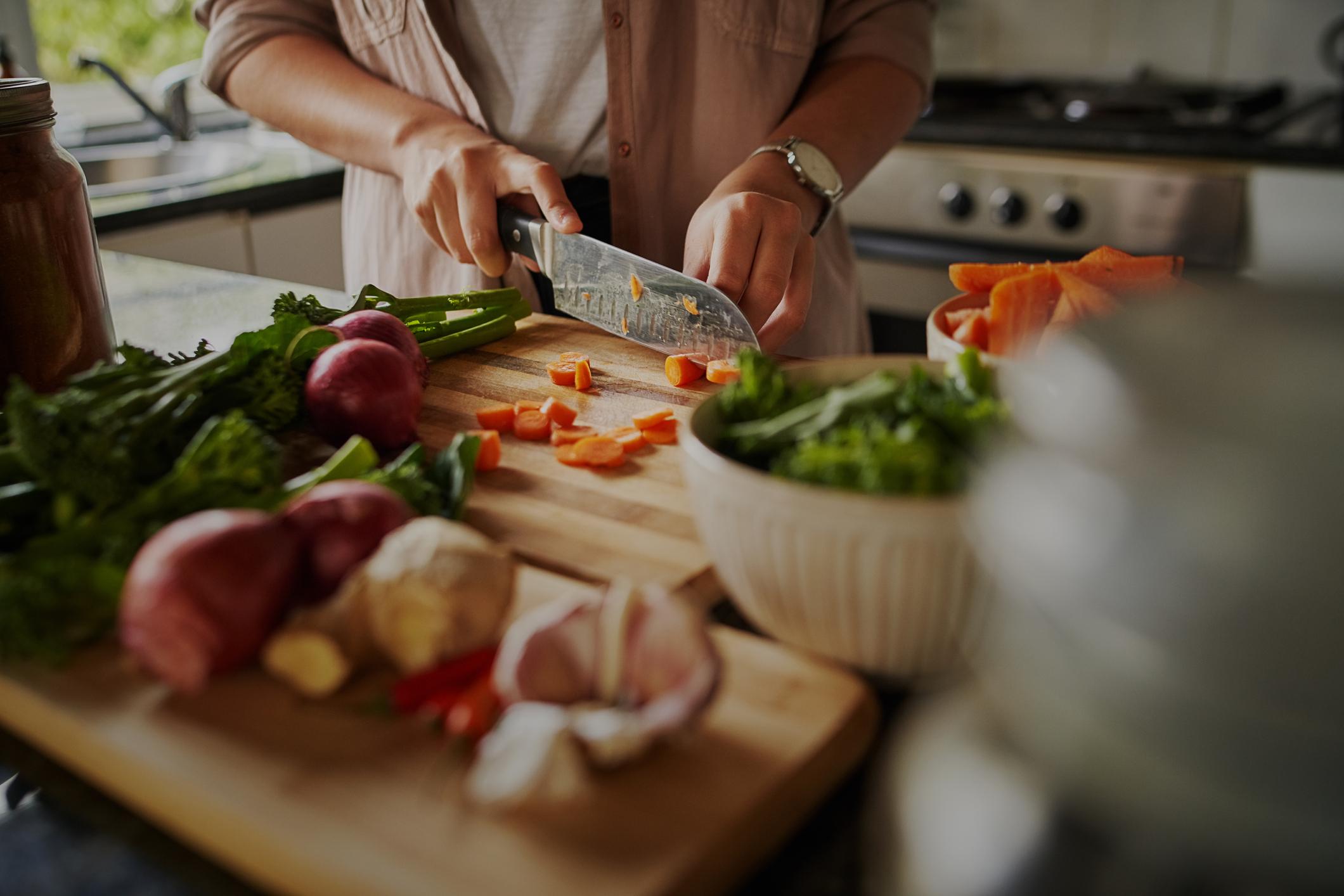 slicing fresh veggies for dinner