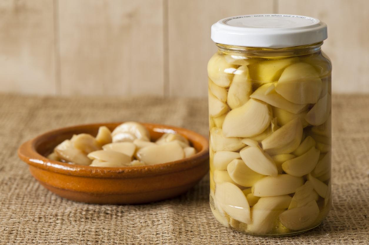 garlic confit in a shallow tapa bowl and inside an airtight glass jar