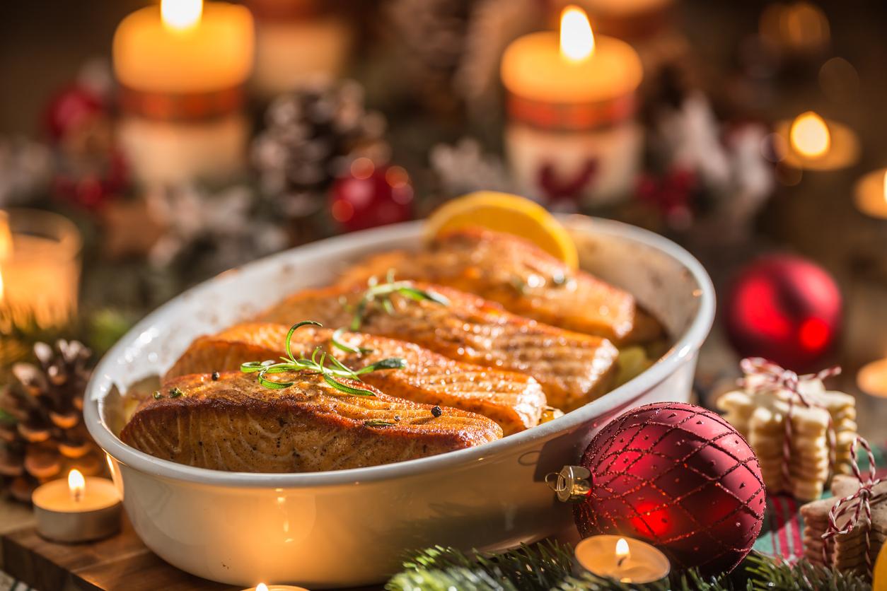 Christmas dinner baked salmon on festive tablescape