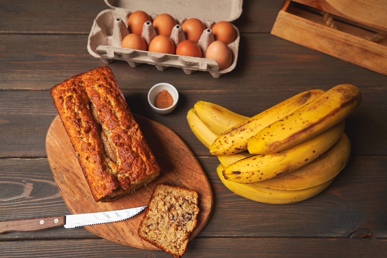 baked banana bread surrounded by healthy ingredients