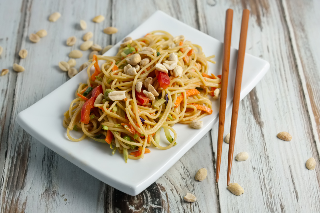 Asian noodles with peanut sauce and mixed vegetables