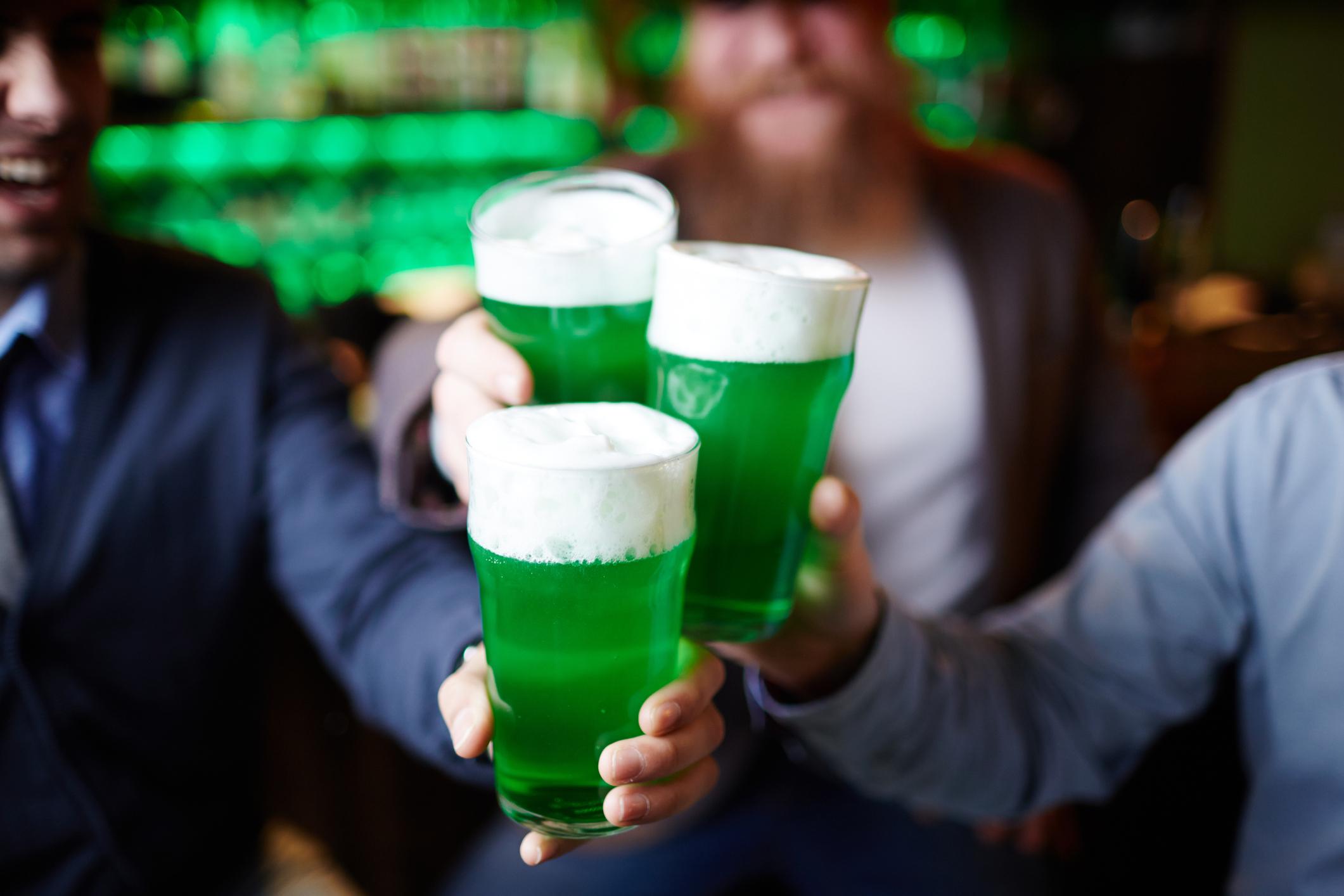cheersing a pint of green beer