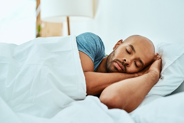 Young man sleeping in his bed.