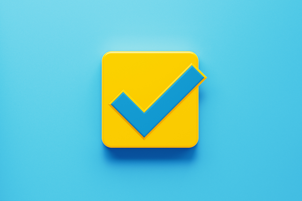 Graphic of a blue check mark against a yellow box on a sky-blue background