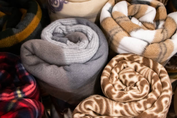 bundles of decorative blankets rolled up