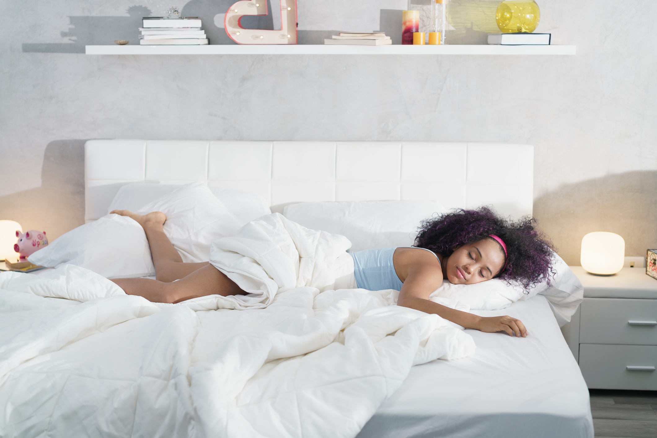 woman sprawled out comfy in bed