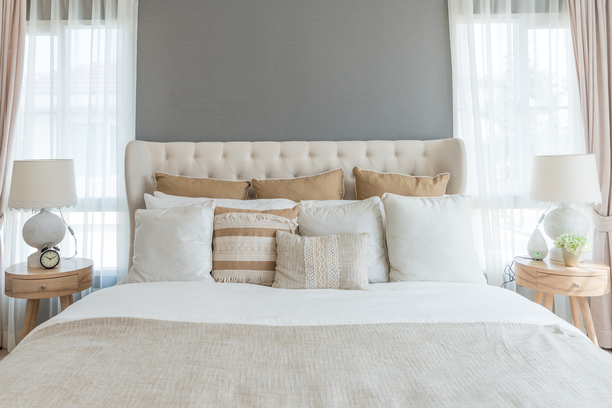 big comfortable double bed in elegant classic bedroom at home