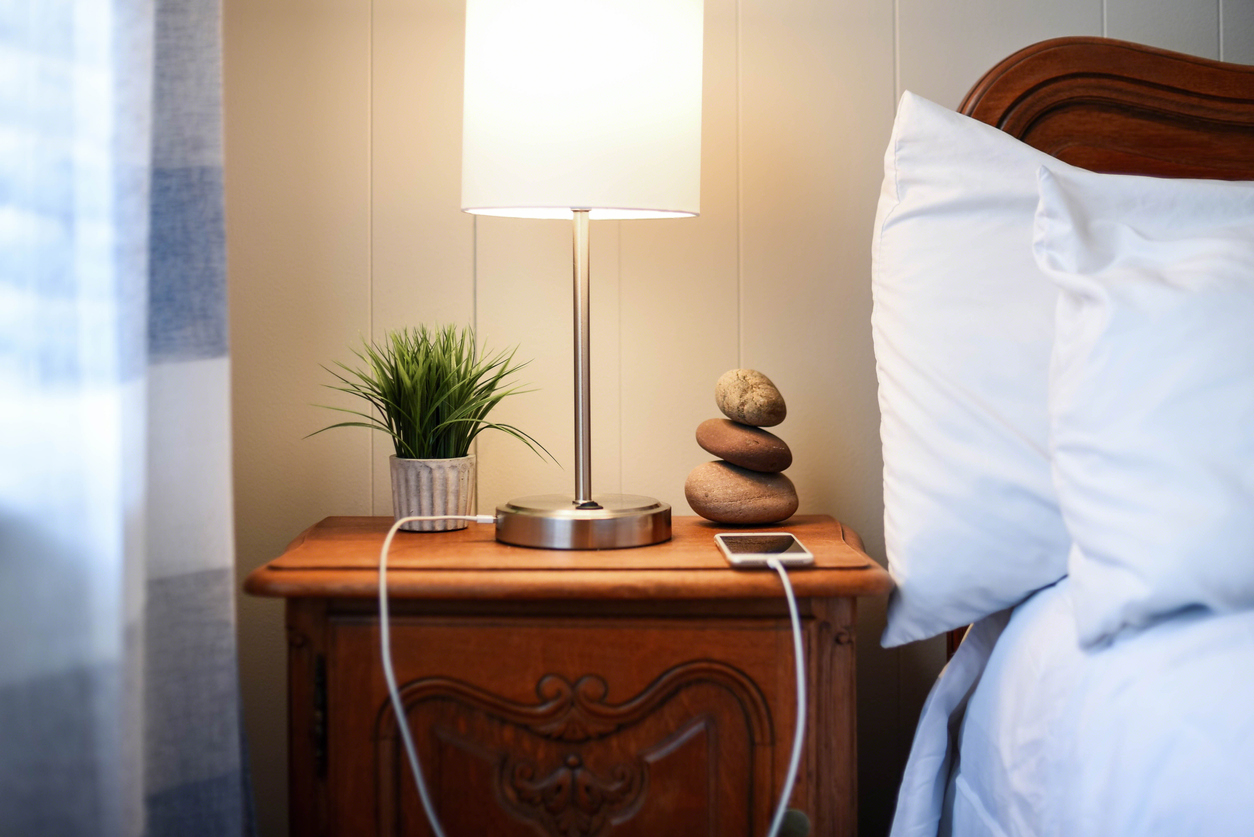 closeup of lamp on nightstand next to bed