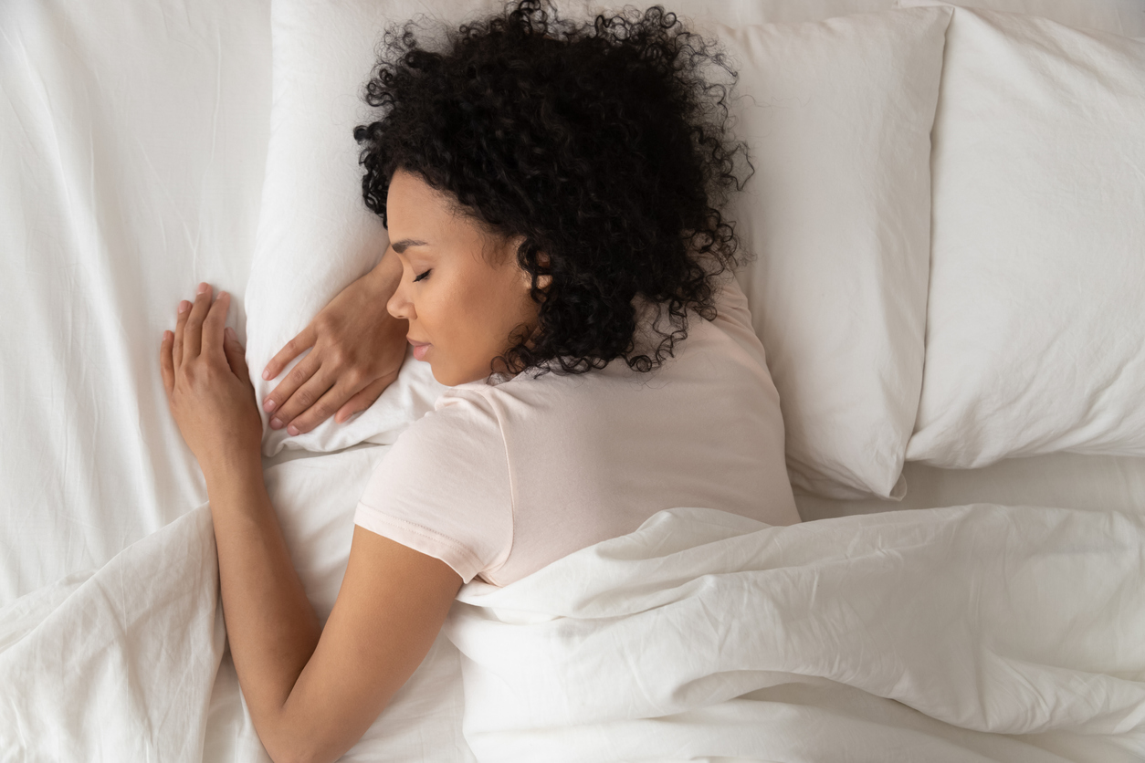 young woman sleeping well on new mattress