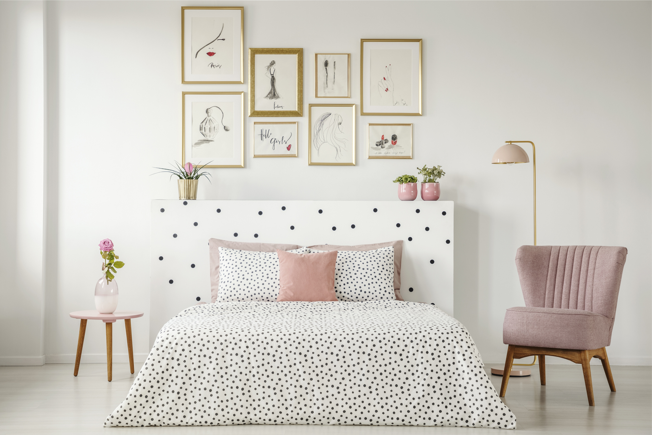 clean bedroom with pink accents
