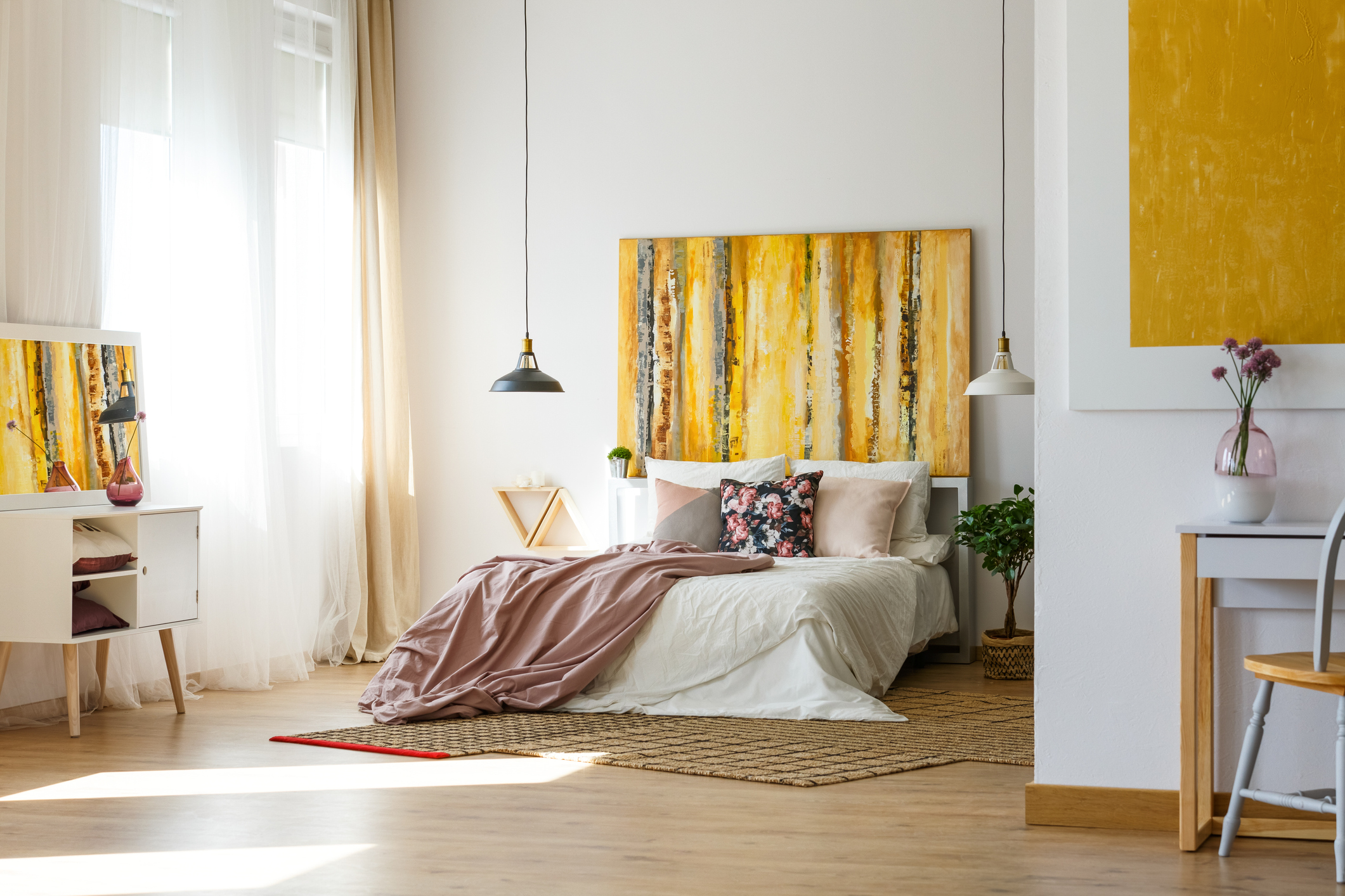 spacious bedroom with yellow accents