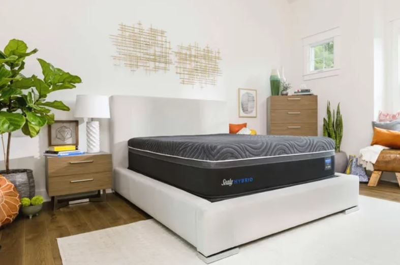 Bedroom with a Sealy hybrid mattress