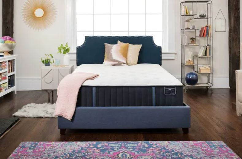 S&F mattress with pillows and a blanket