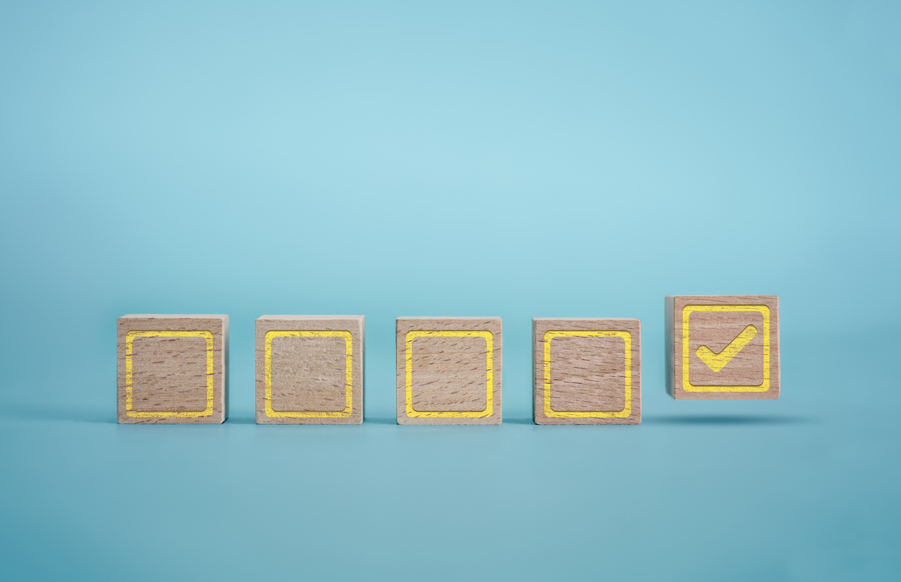 graphic of wooden blocks with yellow check marks on a blue background