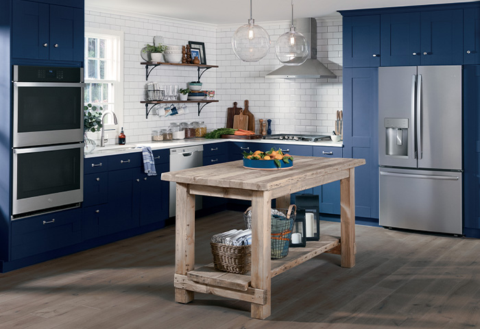 modern blue and white kitchen with GE kitchen appliance package in stainless steel finish