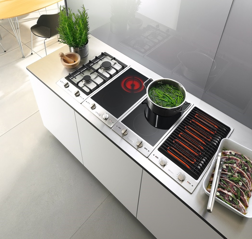 three piece Miele transitional cooktop