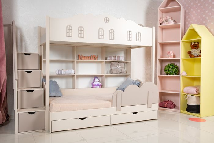 Unisex bedroom with a bunk bed with built-in shelves and drawers