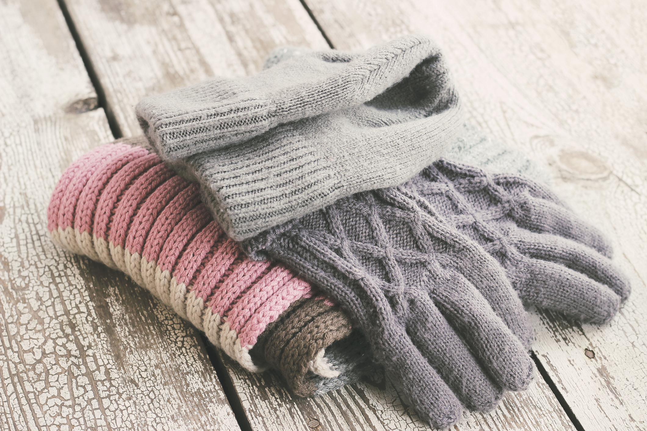 pile of knit hat, gloves, and scarf