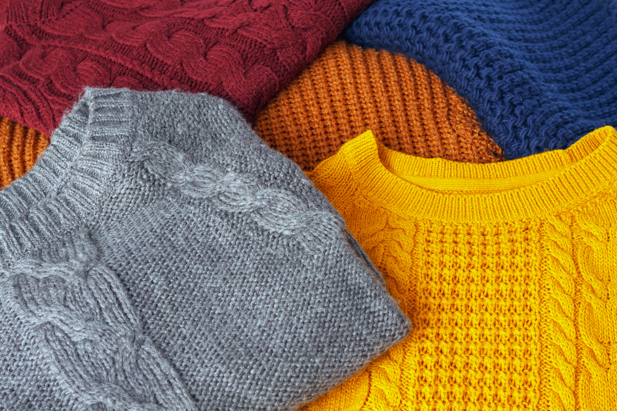 pile of fall sweaters