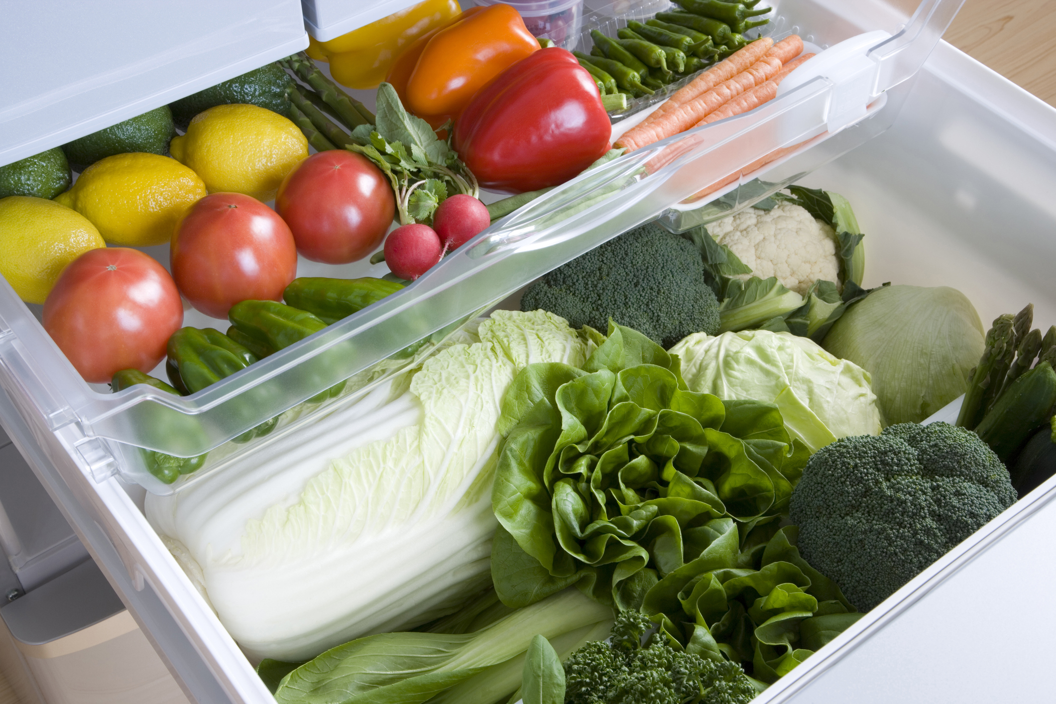 fridge drawers with fruits and veggies