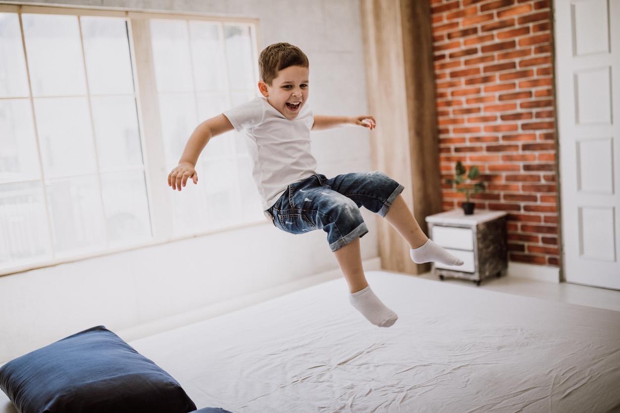 boy jumping on mattress