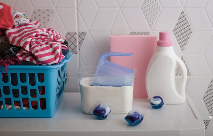 laundry room with liquid, powder, and pod detergent option