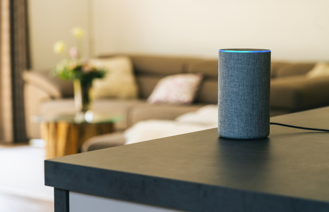 voice control amazon echo on a table in a living room