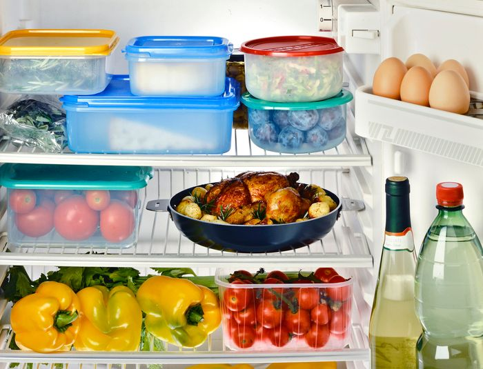 The inside of a refrigerator full of food and leftovers.