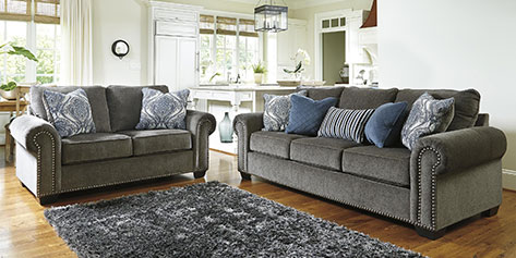 Living room with sofas, chair, and center table