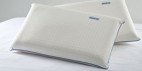 Two pillows on top of a bed