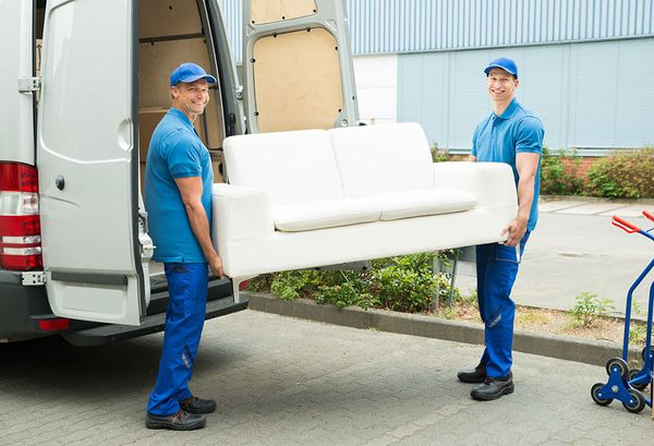 Delivery staff carrying a sofa